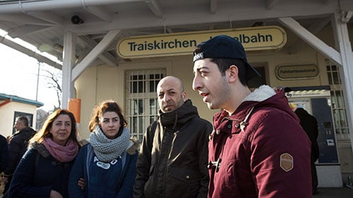 Mohammed Abu Saleh, right, and his father fled Syria, leaving behind his sister and mother. The family was reunited in Austria. (Photo by Courtney Pedroza/Cronkite Borderlands Project)