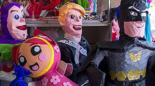 A Donald Trump piñata keeps curious company in Globo Kimba, Javier Velazquez's piñata shop.