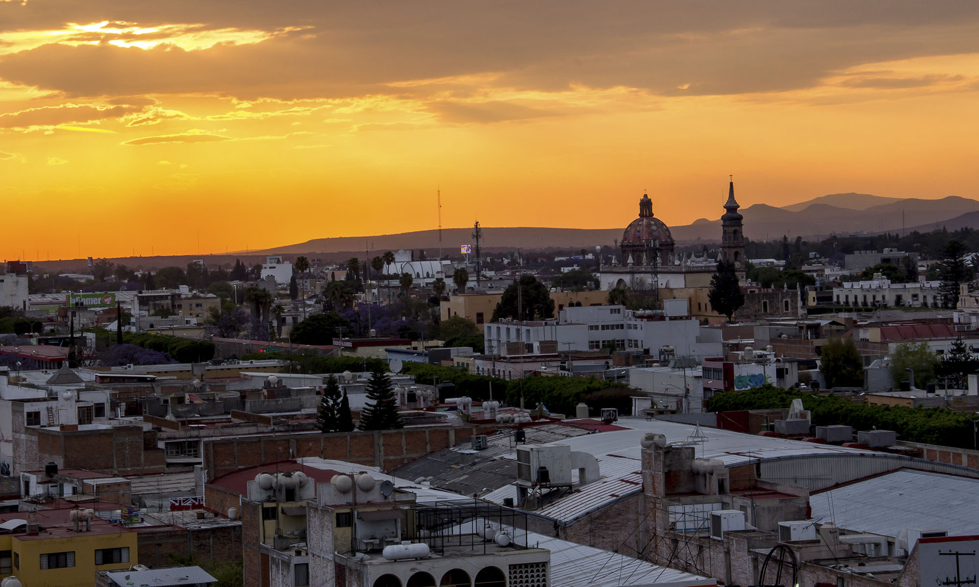 The sun sets over Santiago de Querétaro, the capital and largest city in the state of Querétaro in Mexico.