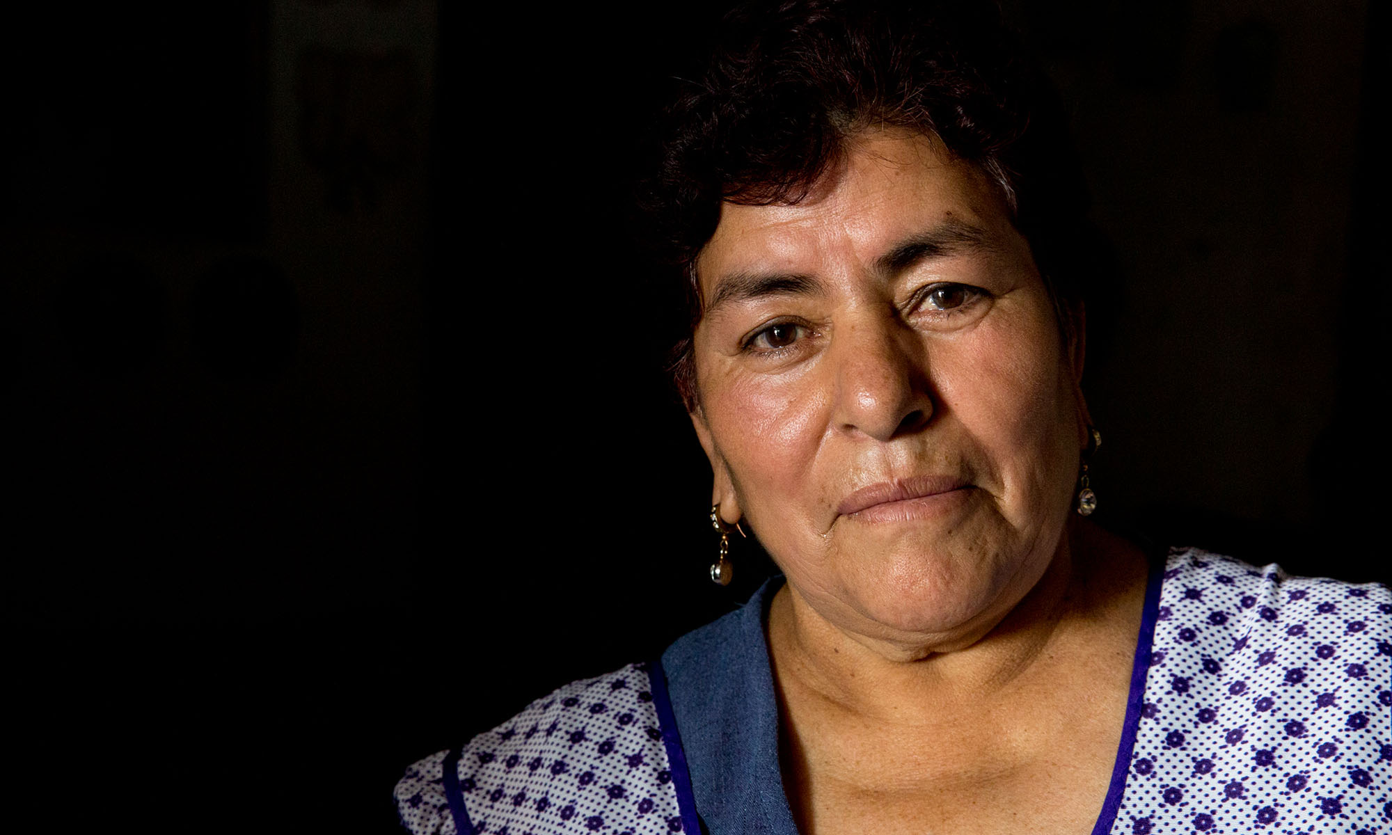"""Efigenia Rodriguez Cecilia is a mother of five with one son in the United States who sends remittances to her every two weeks, when he is paid. He has two U.S.-born daughters whom Rodriguez has only seen online over video calls. During Donald Trump's campaign for president he said that Mexico would pay for a """"big, beautiful wall"""" that would separate Mexico and the United States, even if that meant taxing remittances to Mexican families from the U.S. (Photo by Courtney Pedroza/Cronkite Borderlands Initiative)"""