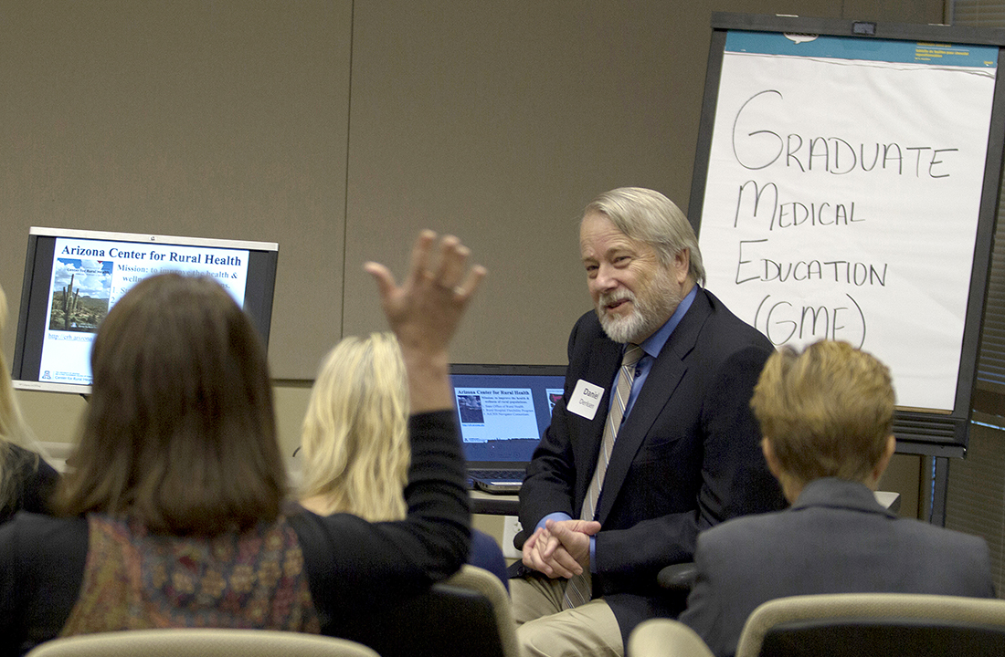 Dr. Daniel Derksen, the director of the Arizona Center for Rural Health at the University of Arizona, speaks to a group of medical and policy professionals about graduate medical education. (Photo by Ally Carr/Cronkite News)