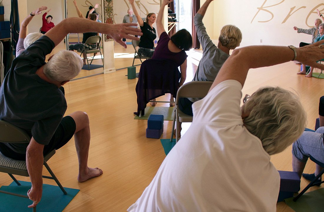 """Inner Vision Yoga Studio in Chandler holds a chair yoga class, which is """"designed to increase circulation and strength,"""" according to the studio's website. (Photo by Ao Gao/Cronkite News)"""