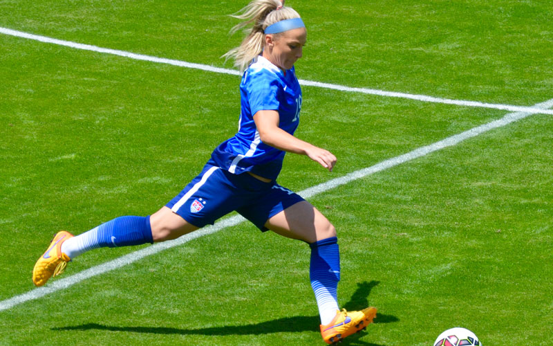 Julie Johnston playing soccer