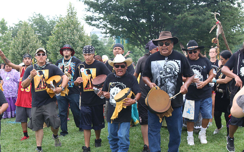 San Carlos Apache drummers lead a group of protesters in songs of prayer in Washington, where they were lobbying to block mining at their sacred land of Oak Flat. (Photo by Jamie Cochran)
