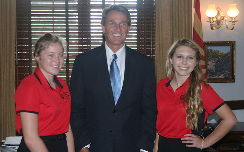 Lora Delahunt, left, and fellow Girls Nation senator from Arizona Kennedy Prock meet with actual Sen. Jeff Flake, R-Arizona, during their whirlwind week of activity in Washington. (Photo by Nihal Krishan)