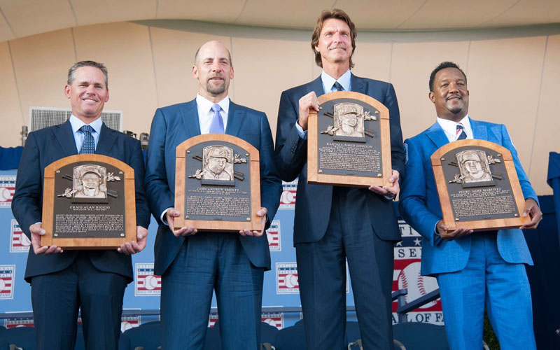Baseball players holding Hall of Fame plaques