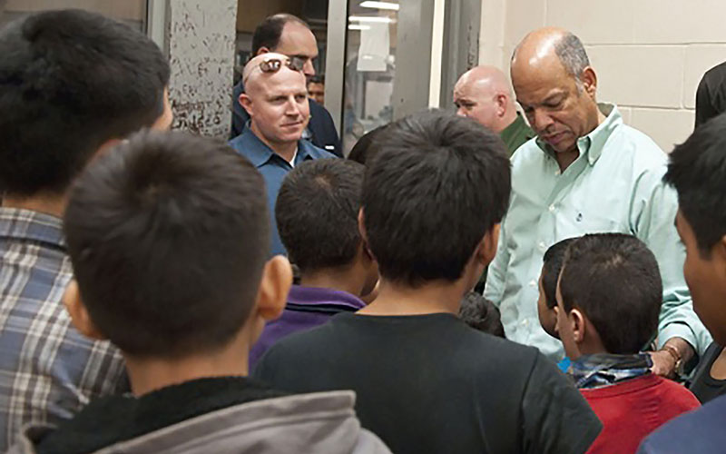 Homeland Security Secretary Jeh Johnson at a Texas facility in 2014 where unaccompanied immigrant children are being processed after being caught crossing the Southwest border into the U.S. (Photo courtesy Department of homeland Security)