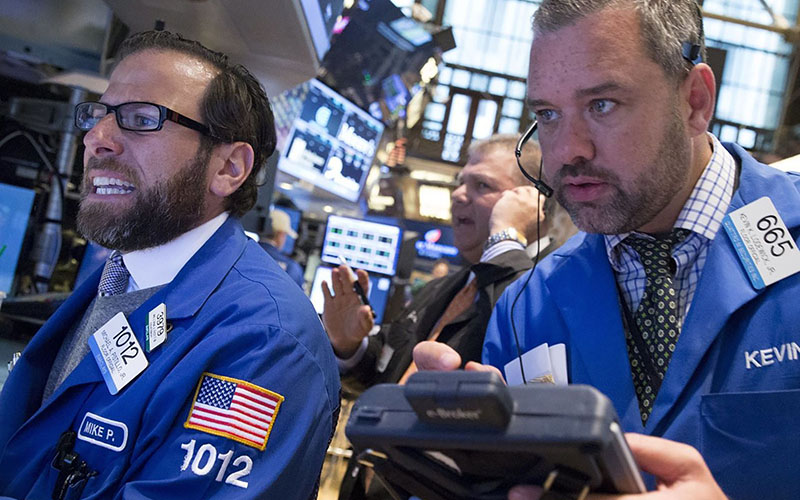 Traders work on the floor of the New York Stock Exchange on Tuesday, when stocks rebounded from a historic drop before falling again sharply before the close. (Photo by Brendan McDermid/Reuters)