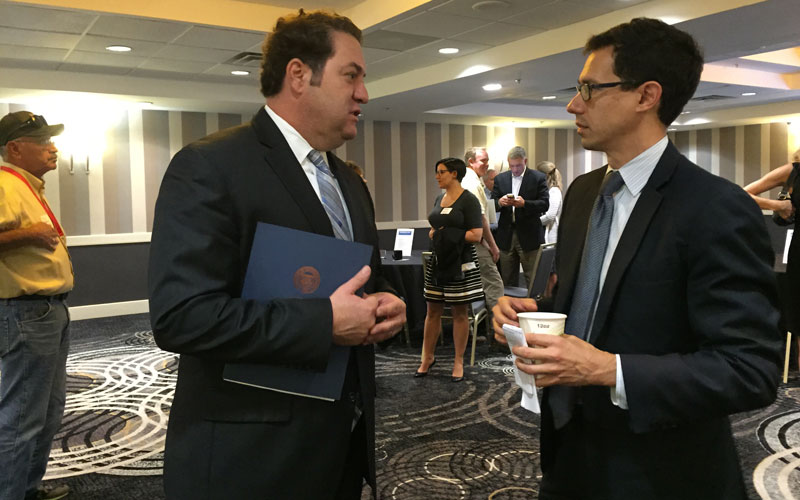 Arizona Attorney General Mark Brnovich (left) speaks to Glenn Hamer, president and CEO of the Arizona Chamber of Commerce and Industry, at a Arizona Manufacturers Council and chamber event. (Photo by Curtis Spicer/Cronkite News)