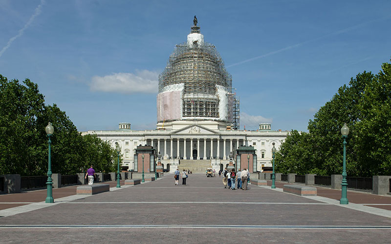 The East Front of the U.S. Capitol, with scaffolding covering the dome, which is under renovation. (Photo courtesy Architect of the Capitol)