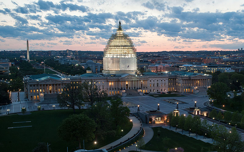 The East Front of the U.S. Capitol at dusk. Scaffolding is covering the dome, which is under renovation. (Photo courtesy Architect of the Capitol)