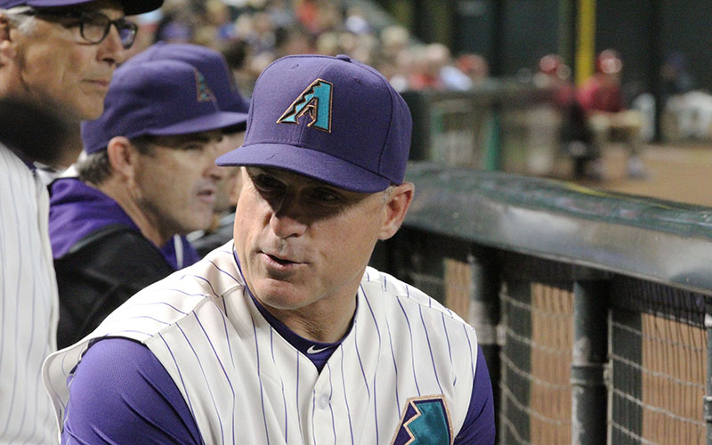77144acf06b Diamondbacks manager Chip Hale wears the team s old purple and teal uniform  on Thursday