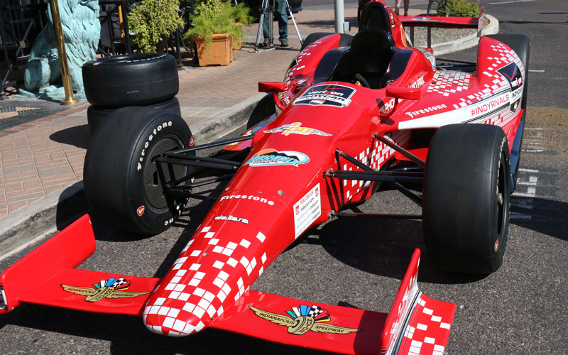 An IndyCar race car sits outside The Capitol Grille at the Biltmore during the 2016 Phoenix Grand Prix announcement on Oct. 27, 2015. (Photo by Maria Vasquez/Cronkite News)