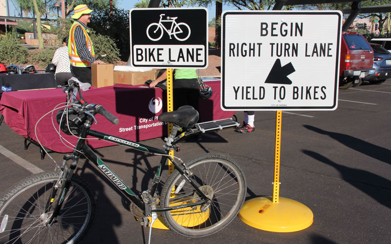 These signs and many others have been placed throughout Phoenix — and will continue to be placed — to help guide bicyclists and motorists in Phoenix. (Photo by Claire Cleveland/ Cronkite News)