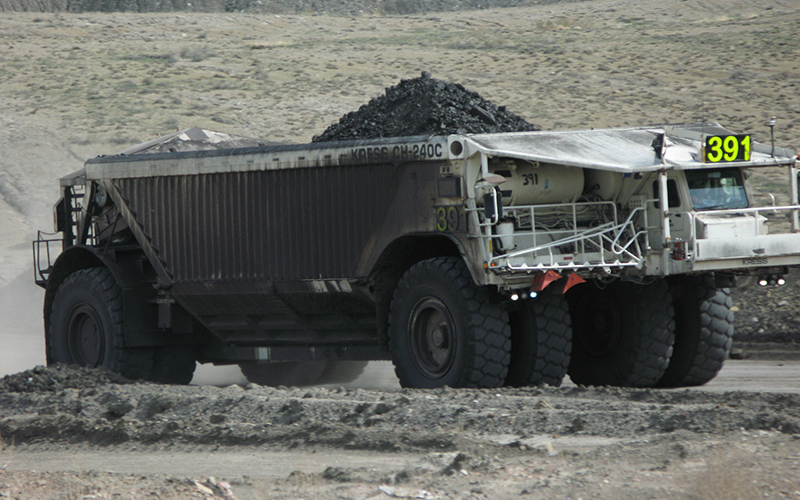 A truck hauls coal at a mine in the Navajo Nation. Declining demand for coal led to the award of a federal grant to help Navajo develop a strategy to deal with the economic impact. (Photo by Kelly Michals via flickr/Creative Commons)
