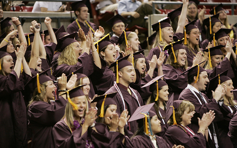 Arizona State University students celebrate in this spring 2006 graduation photo. A new report says 2014 graduates from Arizona had some of the lowest student debt rates in the nation. (Photo by Tom Story/ASU)