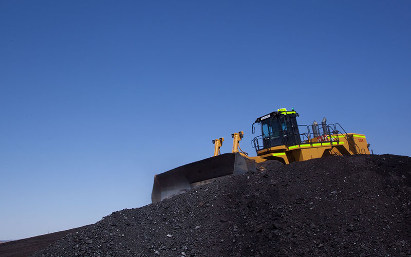 A bulldozer crawls over a pile of coal at Peabody's Kayenta mine on the Navajo Nation in this 2012 photo. (Photo courtesy Peabody Energy)