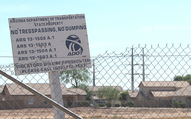 ADOT signs in Laveen, marks the future path of South Mountain Freeway (Photo by Audrey Weil/Cronkite News).