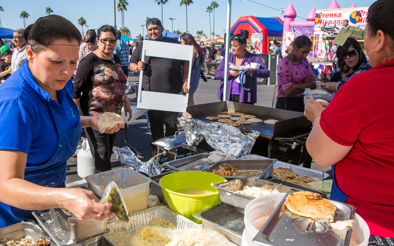 Cooks from the Salvadoreño Restaurant prepare pupusas at the the 8th annual Arizona Pupusa Festival. (Photo by Carla León/Cronkite News)