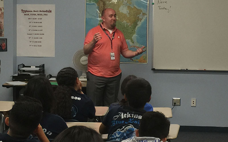 Jacob Lewis teaches a seventh-grade social studies class at Marc T. Atkinson Middle School in Phoenix. Lewis teaches about 9/11 as part of the class.