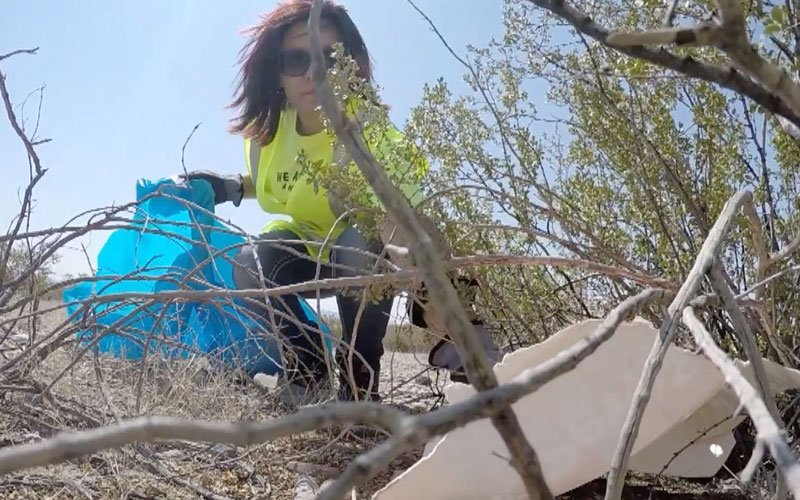 A volunteer for the Adopt a Highway program cleans up debris. (Photo courtesy of Arizona Department of Transportation)
