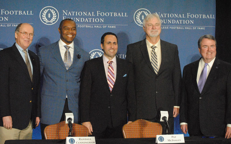 College Football Playoff Executive Director Bill Hancock, 2016 Hall of Famer Randall Cunningham, ESPN's Joe Tessitore, 2016 Hall of Famer Pat McInally and National Football Foundation President and CEO Stave Hatchell pose for media after the 2016 College Football Hall of Class was announced at the JW Marriott Camelback Inn in Scottsdale. (Photo by Bill Slane/Cronkite News)