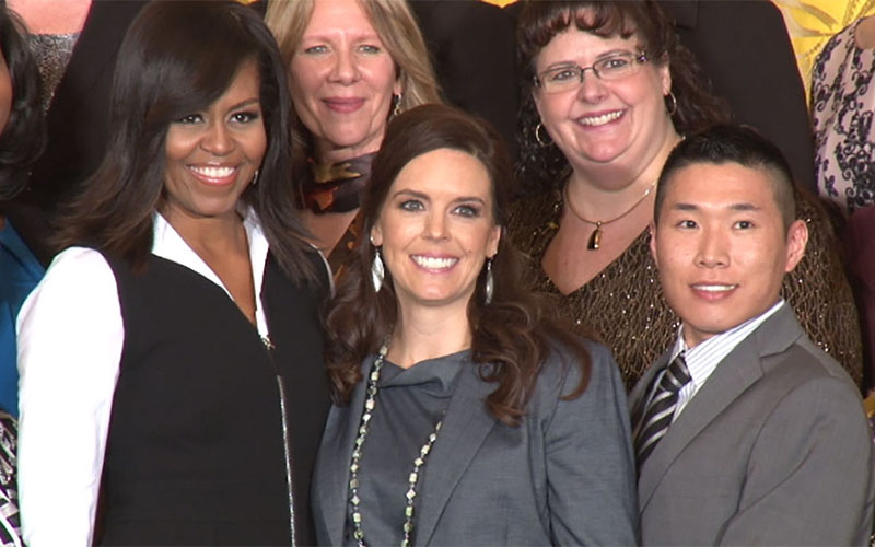 Flagstaff High School guidance counselor Katherine Pastor, center, with first lady Michelle Obama and some of the 41 others being honored at the White House for their work as counselors.