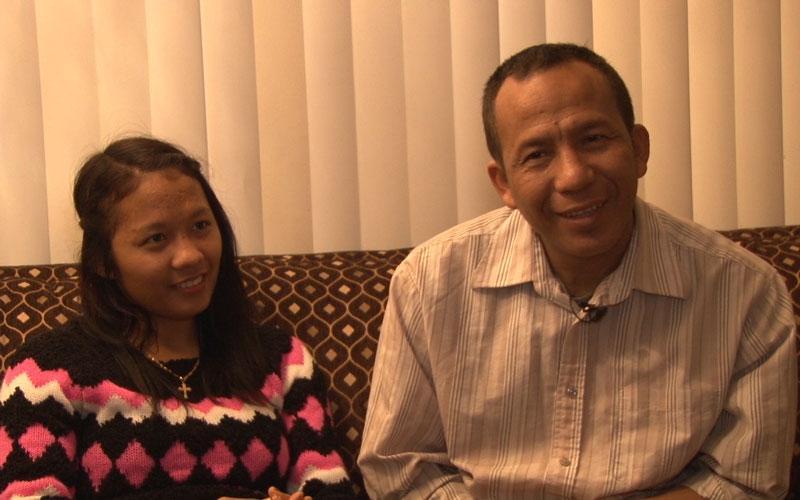 Lal Mawi, 20, and her father, Kawl Biak, 42, in their Phoenix home. (Photo by Josh Burton/Cronkite News)