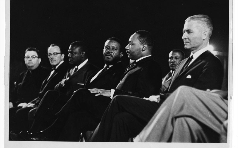 G. Homer Durham, Martin Luther King, Jr.. Ralph Abernathy, an unidentified participant, Rev. Louis Eaton and Msgr. Robert Donahoe at Goodwin Statium, Arizona State University. King spoke earlier in the day at Tanner Chapel A.M.E. Church (Photo courtesty of ASU Repository)