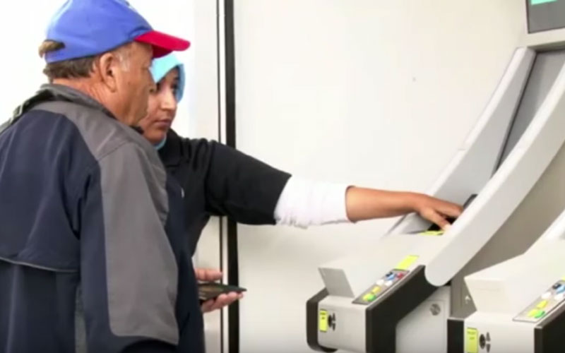 Man using the new biometric technology at a busy border crossing (Photo by Clara Benitez/Cronkite News)