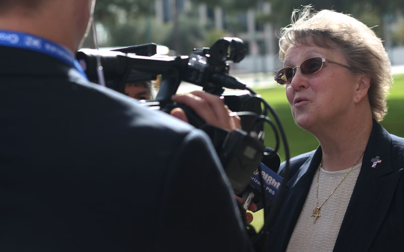 As the rest of the Senate Education Committee moved on to hear other opinions on SB 1416 and eventually other bills, Diane Douglas moved outside for further comment. (Photo by Alex Scoville/Cronkite News)
