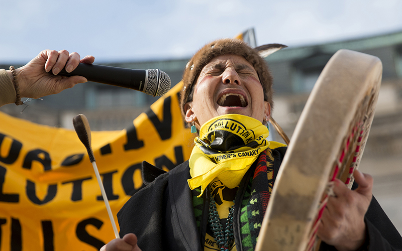 Klee Benally of Navajo Nation and Clean Up the Mines sings during as part of a protest outside the EPA over uranium mines.