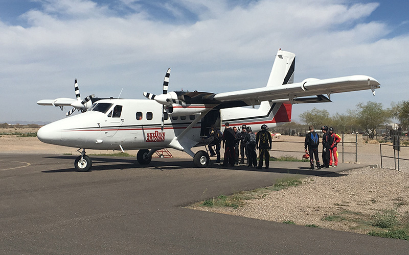 Skydivers line up to load one of Skydive Arizona's planes before take off. (Photo by Chloe Nordquist/Cronkite News)