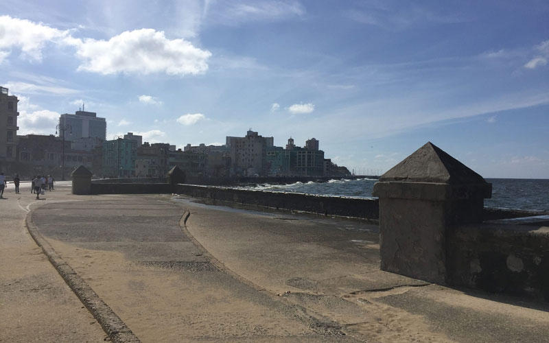 """Americans who visit Cuba may now take a walk along the historic """"malecon"""" or sea wall. (Photo by Baltazar Hernandez)"""