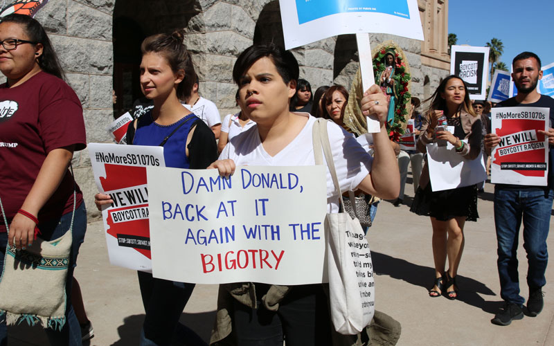 Protestors march at a rally at the Arizona State Capitol Wednesday.(Photo by Gabrielle Abbott/Cronkite News)