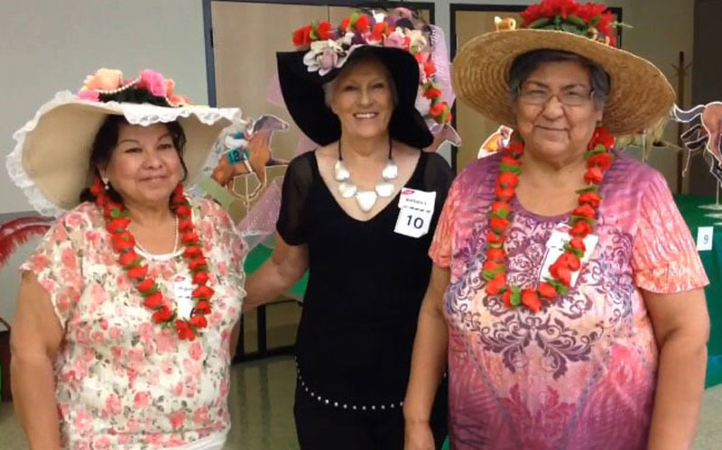 The three winners of the Kentucky Derby Hat contest at Cahill Senior Center. From left to right, Most elegant: Higinia Garcia. Most extravagant: Barbara Lindsay. Most creative: Linda Flores, in Tempe, Ariz.(Photo by Kendall Bartley/ Cronkite News)