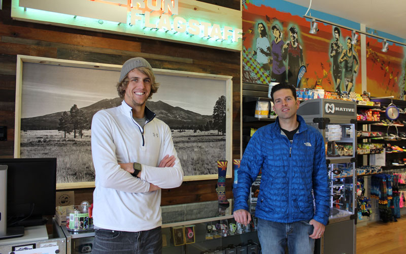 Nick Hilton, left, and Vince Sherry are manager and owner of Run Flagstaff, a specialty running store located on Historic Route 66. (Photo by Kylee Sam/Cronkite News)