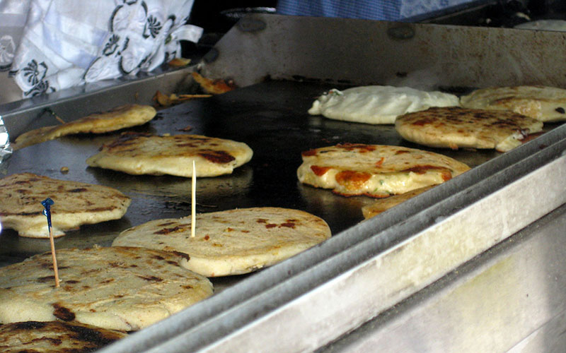 A New York vendor prepares pupusas made with corn masa flour. Health advocates hope the FDA's decision to allow the addition of folic acid to corn masa flour with reduce birth defects.