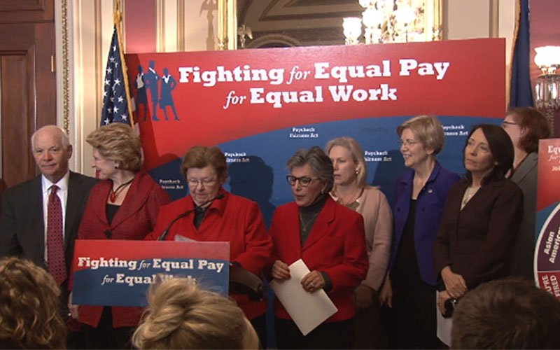 Senators rally for action on a pay equity bill, which has been introduced in both the House and Senate but languished.