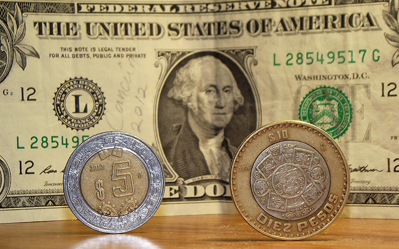 Mexican pesos and the U.S. dollar.