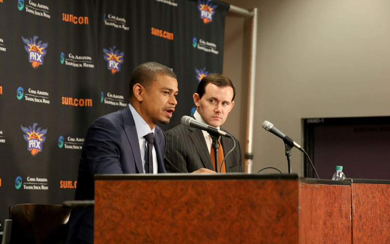 The Suns announced Earl Watson (left) would remain with the team as the new permanent head coach. General Manager Ryan McDonough was impressed with how quickly he was able to get the locker room to buy into him. (Photo by Bill Slane/Cronkite News)