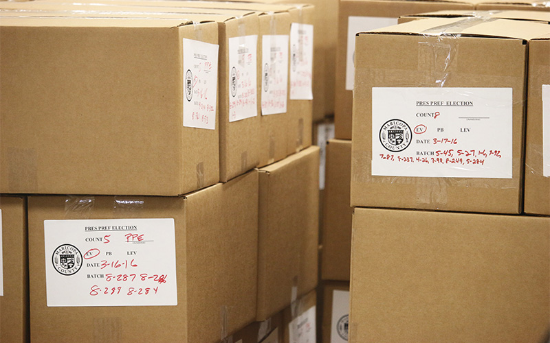 Boxes of Arizona presidential preference election ballots sit at the Maricopa County Elections Warehouse. (Photo by Erin Vogel-Fox/News21)