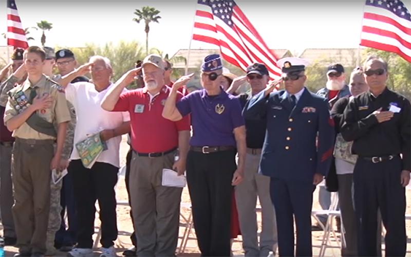 Veterans salute in honor of memorial at Arlington Cemetery.