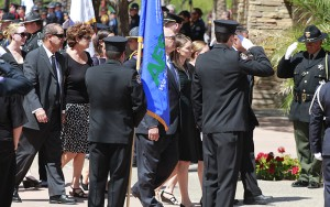 Members of the Glasser memorial are escorted by the Phoenix Police force. (Photo by Christina Tetreault/Cronkite News)
