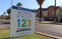 A sign showing support for Proposition 123 on the day of the special election.