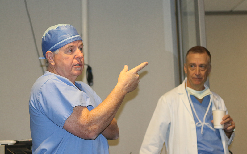 Interventional Cardiologist, Dr. Timothy Byrne and Cardiac Surgeon, Dr. Michael Caskey introduce the transcatheter Aortic Valve Replacement, a revolutionary new technology for heart surgery.  (Photo by Isabel Menzel/Cronkite News)