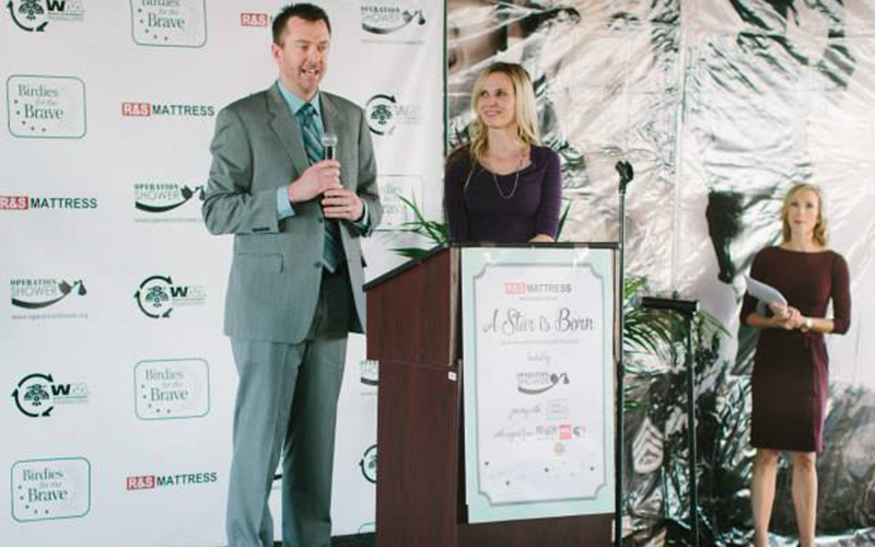 "Brad Ziegler and his wife, Kristen, addressing the mothers-to-be at Operation Shower's ""A Star Is Born"" themed shower in 2015. (Photo courtesy Operation Shower)"