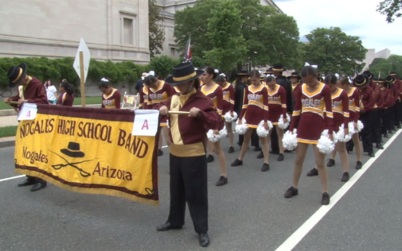 The Pride of Nogales - the high school's marching band, dance team and color guard - prepare to march down Constitution Avenue.