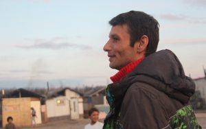"Milán ""Igor"" Hudák, 33, looks on as Gypsy children play in his home ghetto just outside Moldava nad Bodvou, Slovakia."