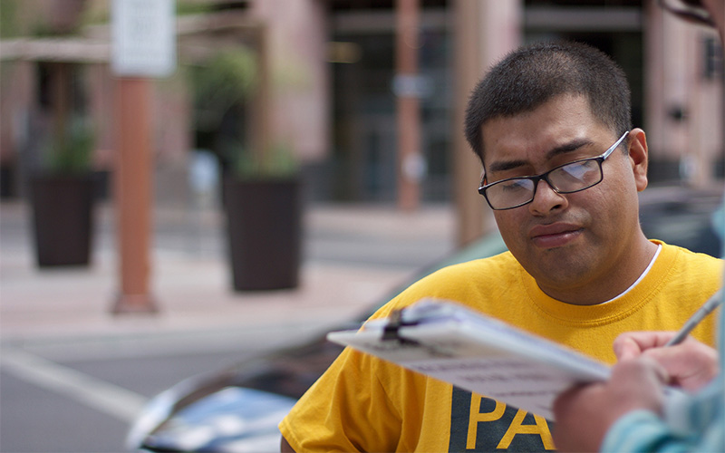 Jose Barboza, a volunteer for Promise Arizona, works to get people registered to vote.